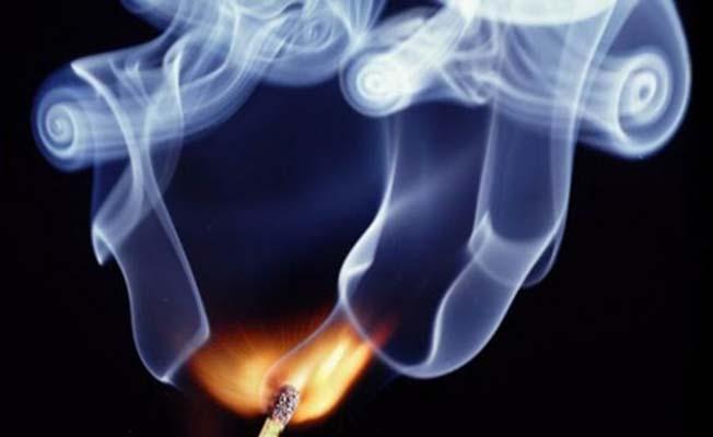 Evin içinde ateş yaktı, dumandan eşi zehirlendi