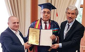 Ali Baklan'a fahri doktoralık unvanı