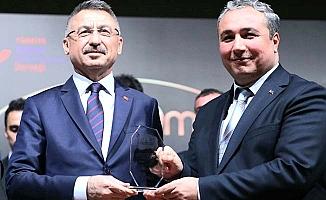 Hemşehrimize kurumsal ödül Oktay'dan