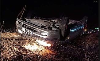 Otomobil devrildi